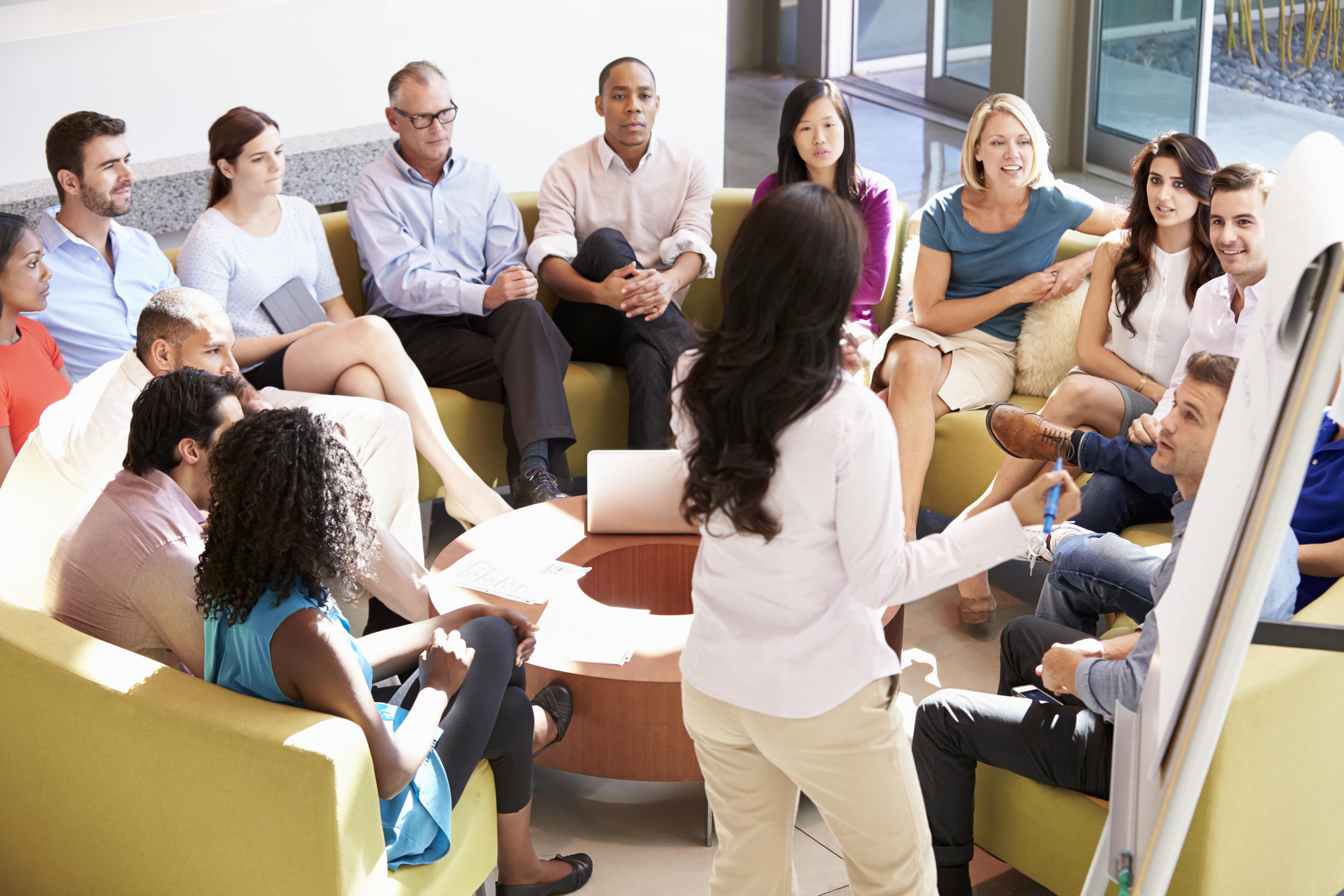 businesswoman-making-presentation-to-office-PRZ3LZR.jpg